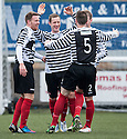 Shire's David Greenhill (2nd left) celebrates after he scores their first goal.