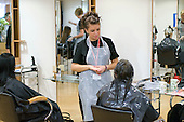 Student chatting easily with a client in the Arena Salon, Hair & Beauty Dept., Kingston College.