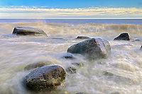 Waves crashing on rocks on shore of Lake Winnipeg<br /> Hecla Provincial Park<br /> Manitoba<br /> Canada