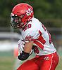 John Mercado #20 of Center Moriches runs the ball during a Suffolk County Division IV varsity football game against host Wyandanch High School on Thursday, Sept. 7, 2017.