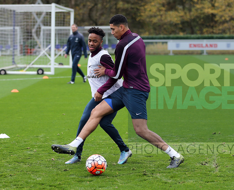 England's Raheem Sterling tussles with Chris Smalling during training<br /> <br /> England Training - Tottenham Hotspur Training Ground - England - 16th November 2015 - Picture David Klein/Sportimage