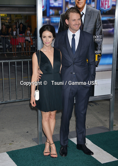 Abigail Spencer and Josh Pence  at the Draft Day Premiere at the Westwood Village Theatre in Los Angeles.