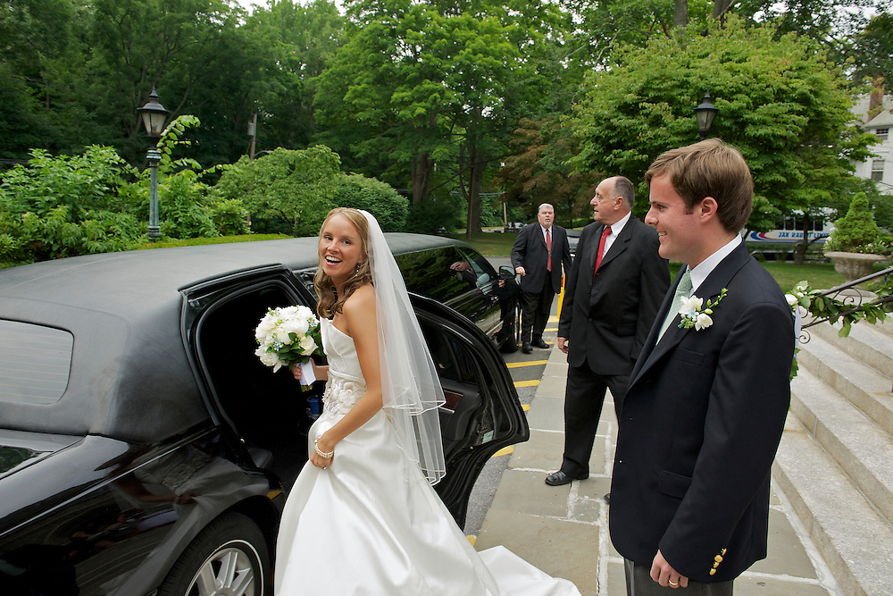 The bride about to enter the limo to head to the reception.