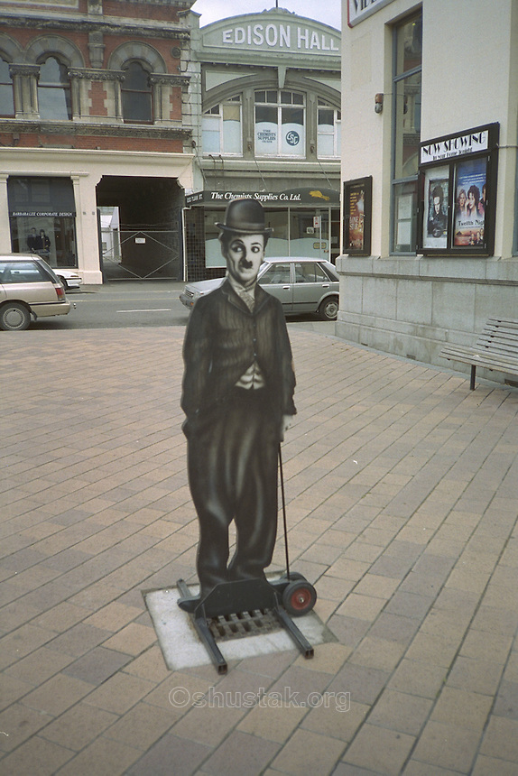 Charlie Chaplin sign outside Alice in Videoland, High St, Christchurch. (Most of the buildings in the background were destroyed in the 2010/2011 earthquakes).