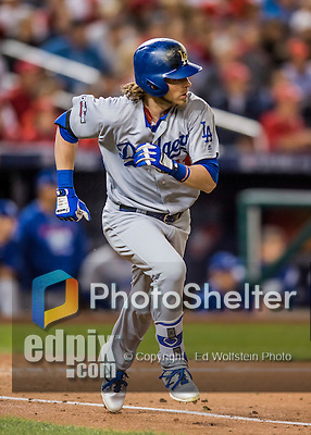 13 October 2016: Los Angeles Dodgers outfielder Josh Reddick hustles to first during the NLDS Game 5 against the Washington Nationals at Nationals Park in Washington, DC. The Dodgers edged out the Nationals 4-3, to take Game 5, and the Series, 3 games to 2, moving on to the National League Championship against the Chicago Cubs. Mandatory Credit: Ed Wolfstein Photo *** RAW (NEF) Image File Available ***