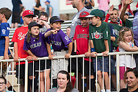 Members of the Optimists youth baseball league line up to parade around the warning track before the South Atlantic League baseball game between the Kannapolis Intimidators and the Hickory Crawdads at Kannapolis Intimidators Stadium on April 22, 2017 in Kannapolis, North Carolina.  The Intimidators defeated the Crawdads 10-9 in 12 innings.  (Brian Westerholt/Four Seam Images)