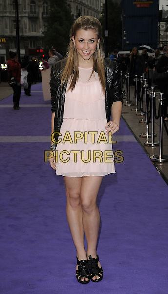 """JEMMA McKENZIE-BROWN.The UK Film Premiere of """"Jonas Brothers 3D Concert Experience"""" at the Empire cinema, Leicester Square, London, England..May 13th 2009.full length black leather jacket pink tiered dress hand on hip shoes sandals .CAP/CAN.©Can Nguyen/Capital Pictures."""