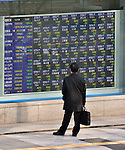 December 4, 2013, Tokyo, Japan - A pedestrian stops to take a glimpse at the electric stock price board of a local brokerage as stock prices take a plunge during the morning session on the Tokyo Stock Exchange market Wednesday, December 4, 2013. The Nikkei 225 Stock Average dropped as much as 403.22 points one time to 15346.44, the lowest level since November 22, 2013.  (Photo by Natsuki Sakai/AFLO)