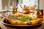 """Oenotri Pepperoni with Red Onion and Star Route Farm Wild Arugula pizza, at Oenotri, a restaurant which specializes in Northern Italian cuisine, located on First Street. The menu changes daily. .Recent development along First Street includes a new boutique hotel, restaurants, and tasting rooms has helped revitalize Napa's downtown, which has recently been coined the """"West End."""""""