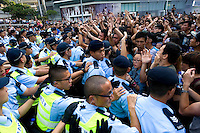 HONG KONG, HONG KONG SAR, CHINA - OCTOBER 13: Scuffles break out between police and 'Occupy Central' protesters in front of Pacific Place shopping mall in Queensway, Admirality, Hong Kong, China, on October 13, 2014. Hundreds of men attempted to break through barricades erected by Hong Kong pro-democracy protesters near the city's business district, as a third week of rallies tried the patience of truck and cab drivers. 'Occupy Central' protesters came back and sit on the pavement to make sure Queensway stayed theirs. The 'Umbrella revolution' or 'Occupy Central' is a civil disobedience movement that began in response to China's decision to allow only Beijing-vetted candidates to stand in the city's 2017 election for the top civil position of chief executive. Thousands of pro-democracy supporters are calling for open elections and the resignation of Hong Kong's Chief Executive Leung Chun-ying. (Photo by Lucas Schifres/Getty Images)