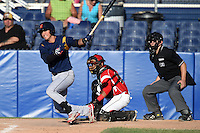 State College Spikes outfielder Jhohan Acevedo (13) at bat in front of catcher Luis Alberto Sanz (19) and umpire Matt Carlyon during a game against the Batavia Muckdogs on June 22, 2014 at Dwyer Stadium in Batavia, New York.  State College defeated Batavia 10-3.  (Mike Janes/Four Seam Images)