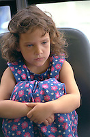 Girl age 6 pouting at the Minneapolis St Paul International Airport.  Minneapolis  Minnesota USA