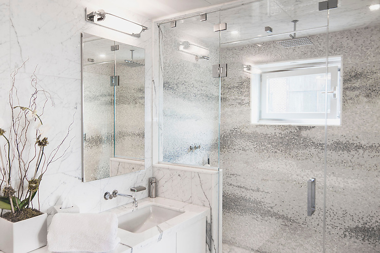 This custom shower designed by Satinwood, Ltd. features Mist, a hand-chopped and tumbled natural stone mosaic from New Ravenna.<br /> <br /> Photo courtesy of Marsha Russell of Satinwood, Ltd.