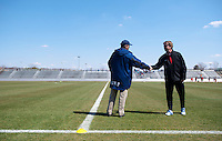 North Carolina head coach Anson Dorrance and Washington Spirit head coach Mike Jorden shake hands on the sideline before the game at the Maryland SportsPlex in Boyds, MD.  The Washington Spirit defeated the North Carolina Tar Heels in a preseason exhibition, 2-0.