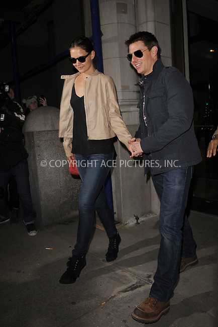 WWW.ACEPIXS.COM . . . . . .December 17, 2011...New York City....Katie Holmes and Tom Cruise leave their apartment on December 17, 2011 in New York City.....Please byline: KRISTIN CALLAHAN - ACEPIXS.COM.. . . . . . ..Ace Pictures, Inc: ..tel: (212) 243 8787 or (646) 769 0430..e-mail: info@acepixs.com..web: http://www.acepixs.com .
