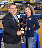 22 November 2008:  Sun Belt Conference Associate Commissioner Rick Mello presents FIU's Natalia Valentin with one of the All Conference Team awards after the WKU 3-0 victory over New Orleans in the championship game of the Sun Belt Conference tournament at U.S. Century Bank Arena in Miami, Florida.