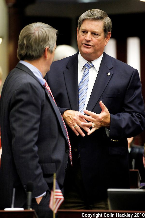 TALLAHASSEE, FLA. 4/30/10-BRONSON 43010 CH01-Agricultural Commissioner Charles Bronson, right, talks with Rep. Bryan Nelson, R-Apopka, during the final day of the 2010 legislative session at the Capitol in Tallahassee...COLIN HACKLEY PHOTO