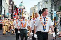 Ireland, July 2013. Orange order marches in the streets of Belfast on July 12th commemorate the protestant victory at the battle of the boyne.  A booming area for nightlife. For decades travellers stayed away from the sectarian violence, but since the end of'The Troubles' more and more people start discoving the beauty of Belfast and the Antrim Coast Causeway. It is the first time that Tallship Thalassa, a barquentine sailing vessel with 3 masts, sails from Belfast to Galway along the Irish coastline. While a full-rigged ship is square-rigged on all three masts, and the barque is square-rigged on the foremast and main, the barquentine extends the principle by making only the foremast square-rigged. The advantages of a smaller crew, good performance before the wind and the ability to sail relatively close to the wind while carrying plenty of cargo made it a popular rig at the end of the 19th century. Photo by Frits Meyst/Adventure4ver.com
