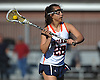 Shea Garcia #22 of Manhasset makes a pass during a Nassau County varsity girls lacrosse game against Long Beach at Manhasset High School on Friday, Apr. 15, 2016. She broke an 8-8 tie and scored the game-winning goal with 44.8 seconds remaining to lead her team to a 9-8 win.