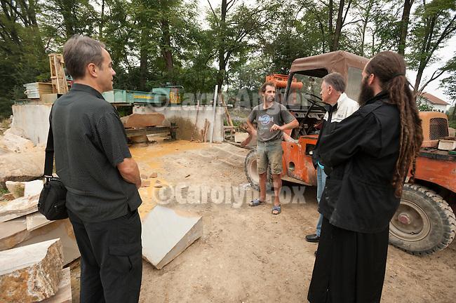 Father Matej checking the travertine stonework for reconstruction of Djurdjevi Stupovi Manasti near Novi Pazar