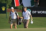 Rory McIlroy walks onto the 18th green with his caddy to finish his round during the Final Day of the Dubai World Championship, Earth Course, Jumeirah Golf Estates, Dubai, 28th November 2010..(Picture Eoin Clarke/www.golffile.ie)