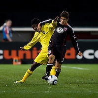 Rodrigo Brasesco (3) of D.C. United fights for the ball with Andres Mendoza (10) of the Columbus Crew during the home opener at RFK Stadium in Washington D.C.  D.C. United defeated the Columbus Crew, 3-1.