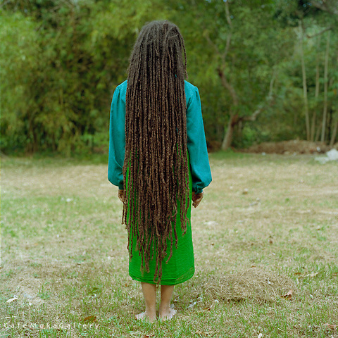 Rear view of a Trinidadian woman with long dreadlocks