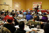 All 67 Iditarod mushers listen to chief veterinarian Stu Nelson during the mandatory mushers meeting on Thursday , March 5th in preparation for the 2009 Iditarod