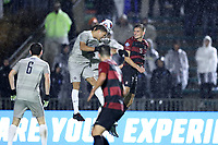 CARY, NC - DECEMBER 13: Rio Hope-Gund #2 and Dante Polvara #17 of Georgetown University beat Keegan Hughes #5 of Stanford University to a header during a game between Stanford and Georgetown at Sahlen's Stadium at WakeMed Soccer Park on December 13, 2019 in Cary, North Carolina.