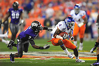 Jan. 4, 2010; Glendale, AZ, USA; TCU Horned Frogs cornerback (7) Greg McCoy attempts to tackle Boise State Broncos wide receiver (4) Titus Young in the first quarter in the 2010 Fiesta Bowl at University of Phoenix Stadium. Mandatory Credit: Mark J. Rebilas-