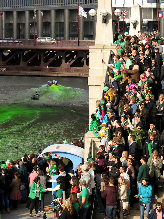 Revelers line the riverfront for the greening of the Chicago River that kicked off the 2015 St. Patrick's Day festivities in downtown Chicago. (Photo by Jamie Moncrief)