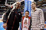 "LOS ANGELES, CA - MARCH 12:  ""One Day One Game"" # Ex-NBA Star and Lakers Forward Michael Thompson and son Klay Thompson of the Golden State Warriors take picture with fan after their NBA Game at the Staples Center  on March 12, 2014 in Los Angeles, California.  (Photo by Donald Miralle for ESPN the Magazine)"
