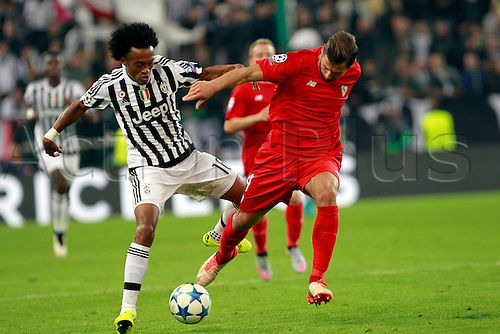 30.09.2015. Turin, Italy. Champions League. Juventus versus Sevilla. Grzegorz Krychowiak and Cuadrado fight for the ball