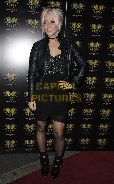 Amelia Lily<br /> The Lipsy VIP Fashion Awards 2013, DSTRKT, Rupert St., London, England.<br /> May 29th, 2013<br /> full length black leather jacket top dress boots hand on hip<br /> CAP/CAN<br /> &copy;Can Nguyen/Capital Pictures
