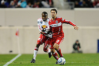 Dane Richards (19) of the New York Red Bulls and Peter Lowry (8) of the Chicago Fire battle for the ball during the second half of a Major League Soccer match between the New York Red Bulls and the Chicago Fire at Red Bull Arena in Harrison, NJ, on March 27, 2010. The Red Bulls defeated the Fire 1-0.