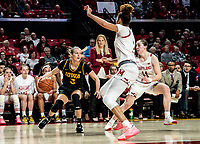 COLLEGE PARK, MD - FEBRUARY 13: Makenzie Meyer #3 of Iowa holds back against Shakira Austin and Taylor Mikesell #11 of Maryland during a game between Iowa and Maryland at Xfinity Center on February 13, 2020 in College Park, Maryland.