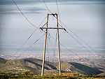 Power poles and transmission lines in the Temblor Range, southern San Joaquin Valley, San Luis Obispo County, Calif.