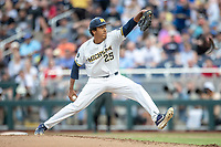 Michigan Wolverines pitcher Isaiah Paige (25) delivers a pitch to the plate against the Vanderbilt Commodores during Game 2 of the NCAA College World Series Finals on June 25, 2019 at TD Ameritrade Park in Omaha, Nebraska. Vanderbilt defeated Michigan 4-1. (Andrew Woolley/Four Seam Images)
