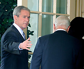 United States President George W. Bush, left, ushers US Secretary of Defense Robert Gates, center, and US Secretary of State State Condoleezza into the Oval Office after delivering a statement on the Russian-Georgian conflict in South Ossetia in the Rose Garden at the White House in Washington on August 13, 2008. Bush announced he will be sending Secretary Rice to the Georgian capitol of Tbilisi. <br /> Credit: Kevin Dietsch / CNP