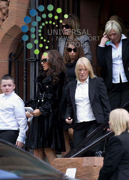 "Family - including woman believed to be girlfriend in black in foreground - follow the coffin of Kevin ""Gerbil"" Carroll leaving the crematorium in Glasgow  to be buried at Langfaulds cemetery just outside Glasgow - more than four months after he was gunned down at Asda..The gangster's family have been told he must not be cremated while his murder is still unsolved..Daniel crime clan enforcer Carroll was shot more than 10 times as he sat in a car outside the Asda store in Robroyston, near Glasgow..18 May 2010 Picture: Universal News And Sport (Scotland)....."