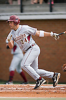 First baseman Dennis Guinn (24) of the Florida State Seminoles follows through on his swing versus the Wake Forest Demon Deacons at Gene Hooks Stadium on the campus of Wake Forest University in Winston-Salem, NC, Friday, March 28, 2008.