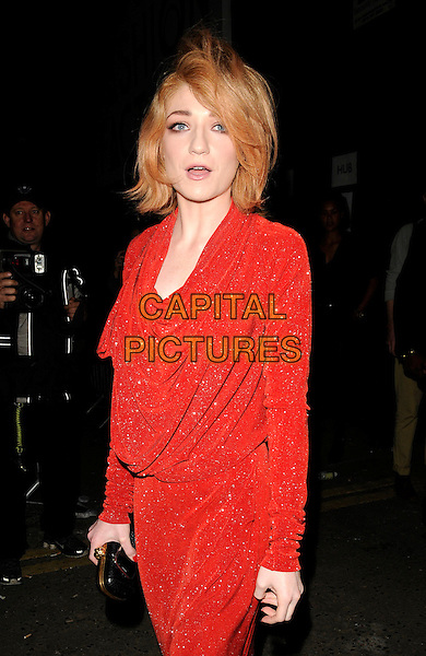 NICOLA ROBERTS (Girls Aloud).At the Vivienne Westwood Show, London Fashion Week Day 3, The Old Sorting Office, London, England, UK,.September 20th 2009..half length red dress long sleeved cowel neck black clutch bag draped sparkly sleeves mouth open .CAP/CAN.©Can Nguyen/Capital Pictures.