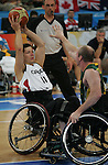 Jaimie Borisoff (11) of Vancouver holds the ball away from an Australian defender in the gold medal game in men's wheelchair basketball action in Beijing during the Paralympic Games, Tuesday, Sept., 16, 2008.   Photo by Mike Ridewood/CPC