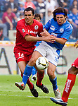 Cruz Azul forward Gabriel Pereyra (R) fights for the ball with Toluca defender Javier Rosada during their quarter finals soccer match at the Azul Stadium, May 6,2006. Cruz Azul tied 1-1 to Toluca ( 2-3 on aggregate). Toluca goes to semifinals of the Mexico's soccer tournament. Photo by © Heriberto Rodriguez