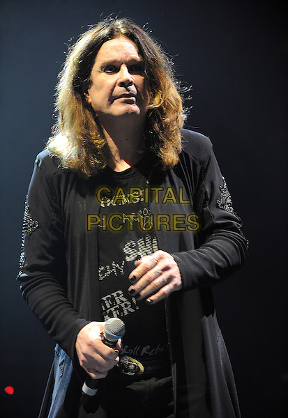 OZZY OSBOURNE .performs at Madison Square Garden as his 2010 Scream Tour makes a stop, New York, New York, USA, .1st December 2010..music live on stage gig concert half length black nails nail varnish polish microphone t-shirt cardigan .CAP/ADM/MOO.© Moose/AdMedia/Capital Pictures.