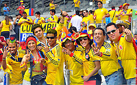 BELO HORIZONTE - BRASIL -14-06-2014. Los hinchas colombianos viven una fiesta en el estadio Mineirao de Belo Horizonte durante el partido del Grupo C entre Colombia (COL) y Grecia (GRC) hoy 14 de junio de 2014 en la Copa Mundial de la FIFA Brasil 2014./ Fans of Colombia live a party live a praty at Mineirao stadium in Belo Horizonte during the match of the Group C between Colombia (COL) and Grece(GRC) today JUne 14 2014 in the 2014 FIFA World Cup Brazil. Photo: VizzorImage / Alfredo Gutiérrez / Contribuidor