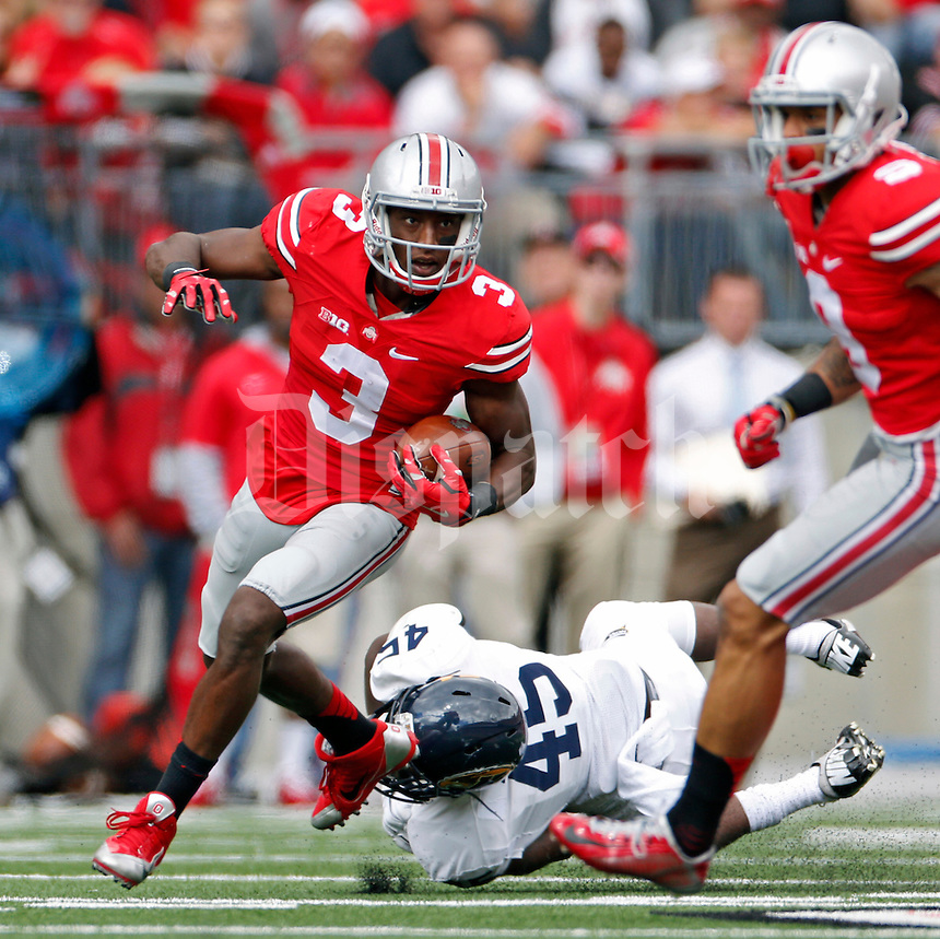 Ohio State Buckeyes wide receiver Michael Thomas (3) breaks away from Kent State Golden Flashes linebacker Marques Moore (45) and scores a touchdown on a catch in the 2nd quarter of their game in Ohio Stadium on September 13, 2014.  (Dispatch photo by Kyle Robertson)