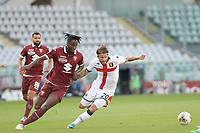16th July 2020; Olympic Grande Torino Stadium, Turin, Piedmont, Italy; Serie A Football, Torino versus Genoa; Soualiho Meite of Torino FC challenges Lasse Schone of Genoa FC