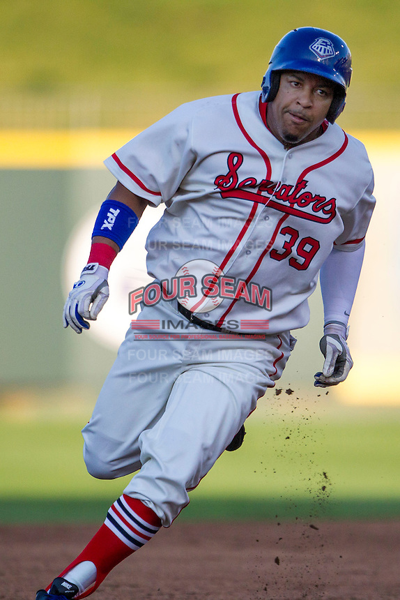 Wearing an Austin Senators throwback uniform, Round Rock Express designated hitter Manny Ramirez (39) rounds second base during the Pacific Coast League baseball game against the Oklahoma City RedHawks on July 9, 2013 at the Dell Diamond in Round Rock, Texas. Round Rock defeated Oklahoma City 11-8. (Andrew Woolley/Four Seam Images)