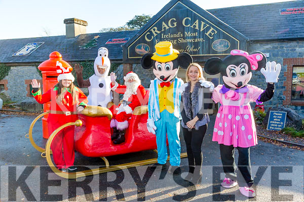 Christmas shopping in Castleisland Crag Cave's  manager Lisa Geaney with Santa and Cartoon characters at th launch of their winter wonderland